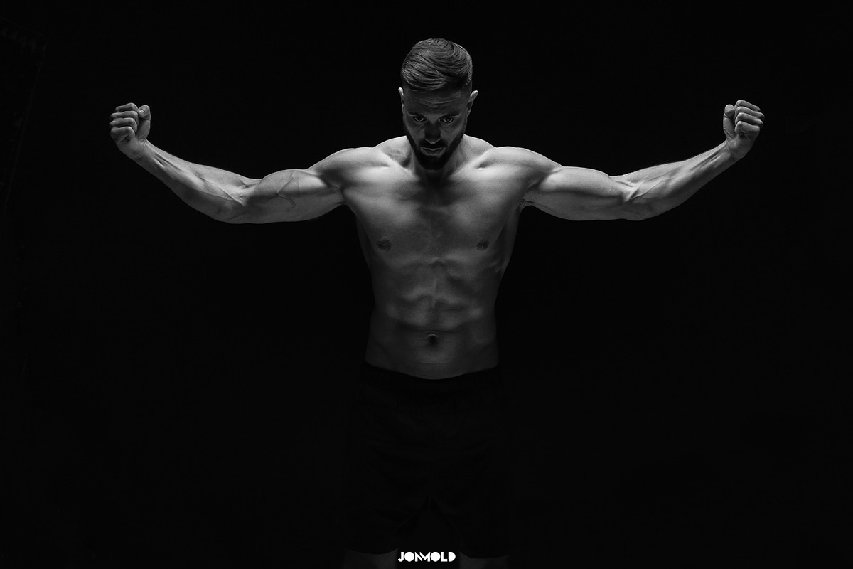 Male physique showing muscles