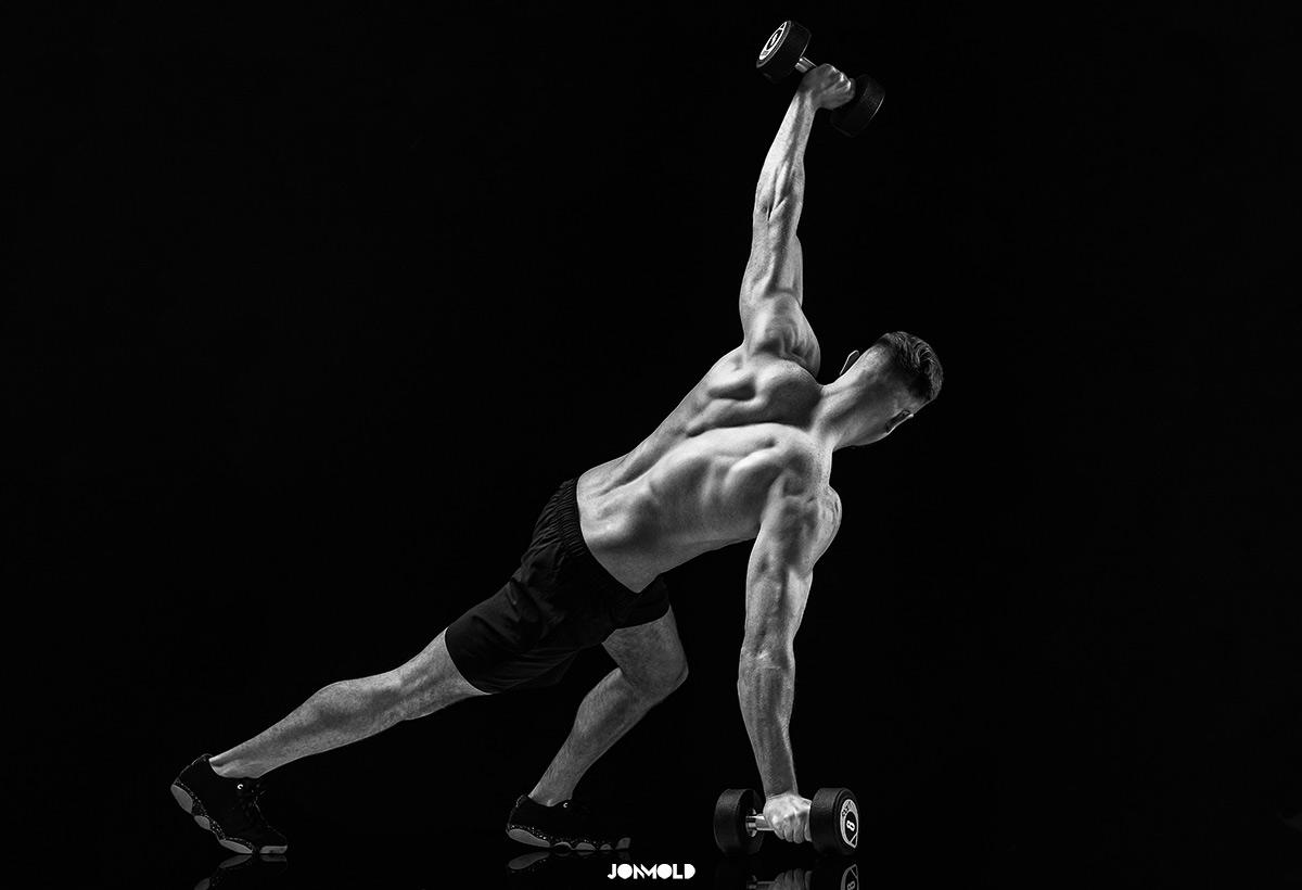 Male fitness model with dumbells